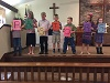 October 2016: Late Elementary Sunday School Class reads a poem dedicated to pastors.