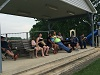 Spectators watching the adult baseball game.  Fun in the Son Picnic!
