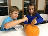 October 2016: Kids Club paints pumpkins to get ready for Glow for God.